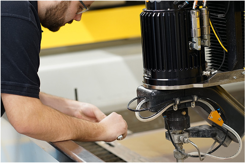 Man Fixing - TECHNI Waterjet